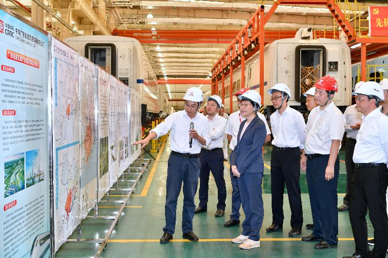 The Chief Executive, Mrs Carrie Lam, tours the CRRC Guangdong depot in Jiangmen today (May 18). Photo shows Mrs Lam (fourth right); the Mayor of the Jiangmen Municipal Government, Mr Liu Yi (first right); and the Secretary for Constitutional and Mainland Affairs, Mr Patrick Nip (third right), receiving a briefing from a representative of the company on its operation.